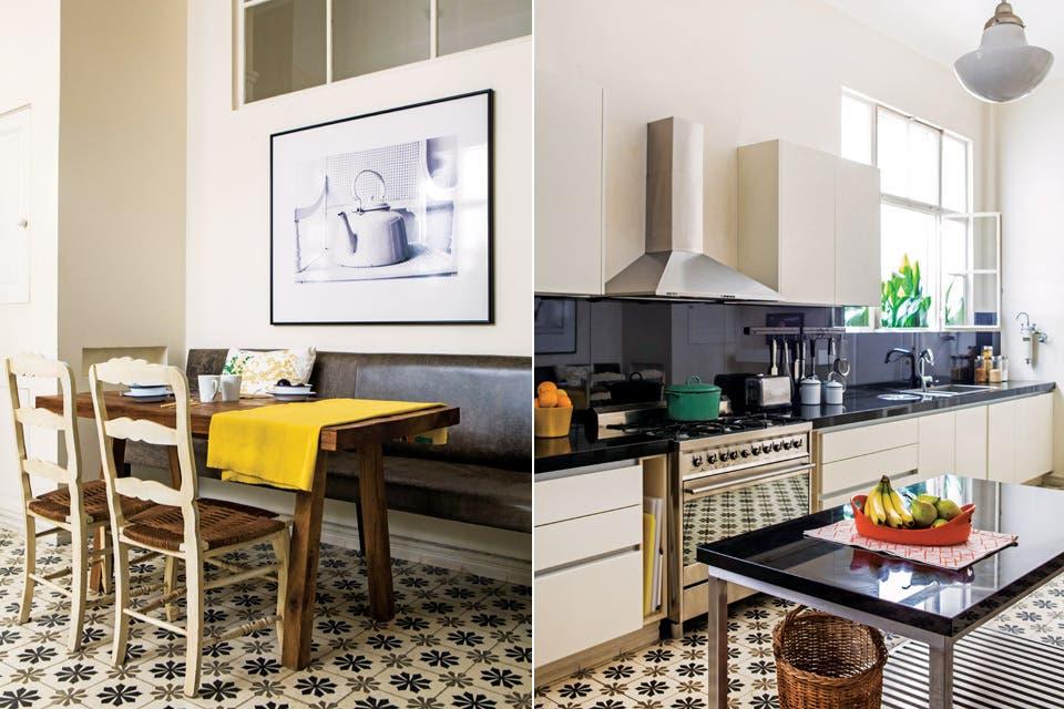 Los muebles (Mi Cocina) tienen frente blanco laqueado y mesada de granito negro Brasil, respetando la consigna de simpleza y linealidad. En acero inoxidable, a tono con las patas de la isla central, cocina de 6 hornallas (Smeg) y campana 'Prima' (Spar Franke). Toda la pirotecnia estética, en el piso.  Foto:Living /Santiago Ciuffo