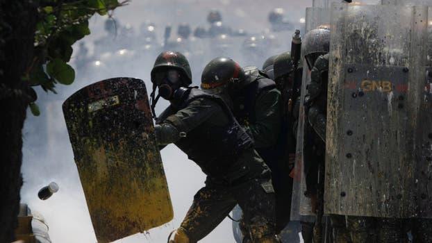 Violenta represión de la policía con los manifestantes. Foto: AFP / Fernando Llano