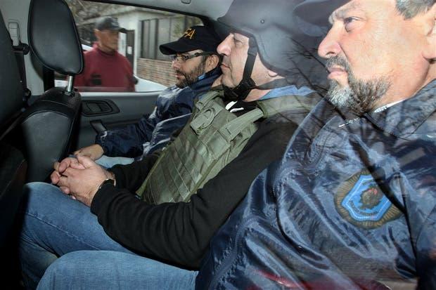 Minnicelli fue trasladado al juzgado con chaleco antibalas y casco