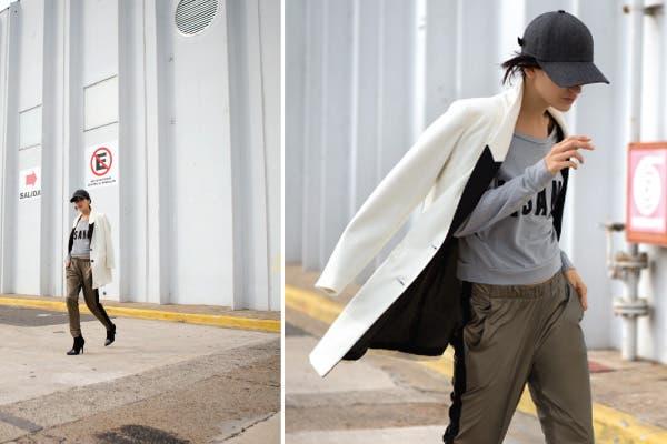 Buzo corto (Muaa, $280), tapado con solapas de cuero (Maria Vazquez, $1999), pantalón con cierres (MesSage, $459), gorrita (Levi's, $229), botinetas bicolor (Natacha, $1090). Foto: Coni Dietrich
