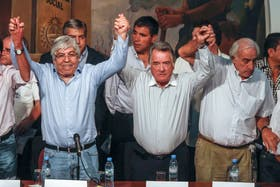 Hugo Moyano, Luis Barrionuevo y Roberto Fernández (de UTA), la semana pasada, cuando anunciaron el paro general