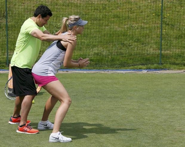 Mejores laburos del mundo 1) Fotógrafo de Playboy 2) Entrenador de Sharapova 3) Redactor de flashes deportivos.  Foto:Reuters