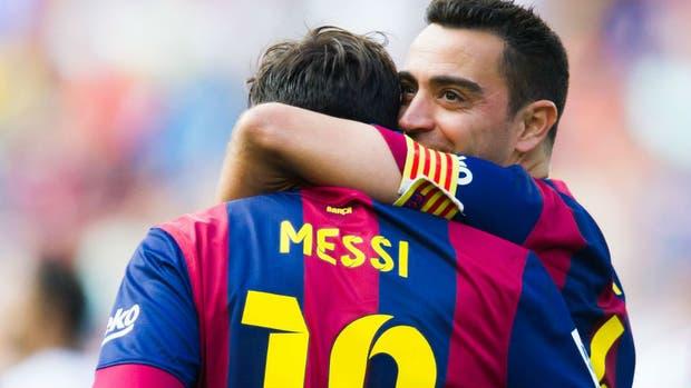 Hernández y Messi defendiendo la camiseta de Barcelona