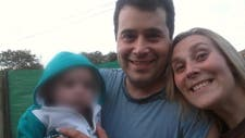 Cabo principal Fernando Santilli junto a su esposa y su hijo de un año