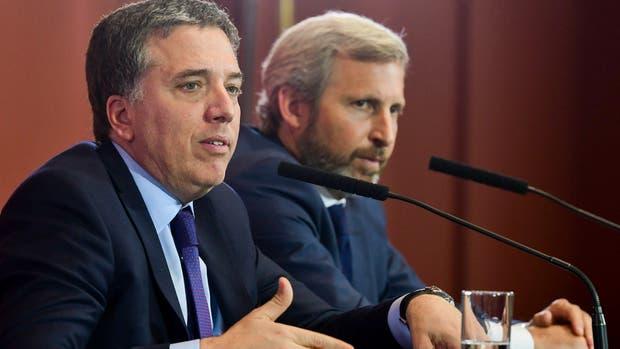 Dujovne y Frigerio durante la conferencia de prensa en la Casa Rosada