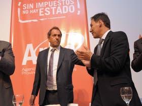 El gobernador Daniel Scioli junto al titular de ARBA, Martín Di Bella