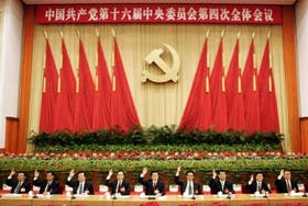 Nine senior members of the Standing Committee of the Political Bureau of CPC present at the Fourth Plenum of the 16th CPC Central Committee in Beijing, Sunday, Sept. 19, 2004. Chinese President Hu