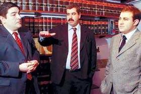 Vattuone, Echenique y Caucino, tres miembros de la Fundación Bicentenario, en su sede de la calle Suipacha