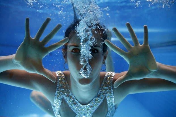 Desde los Flashes, Gordon te quiere decir que sos muy linda, incluso abajo del agua..  /Fotos de EFE, AP, AFP y Reuters