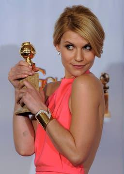 El Globo de Oro a mejor actriz en una miniserie se lo quedó Claire Danes por la ficción Temple Grandin.. Foto: AP