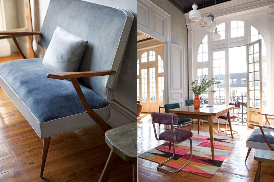 Mesa de estilo escandinavo, sillas retapizadas con géneros traídos de Estados Unidos y colección de lámparas de vidrio opalino de distintos orígenes.  Foto:Living /Javier Picerno