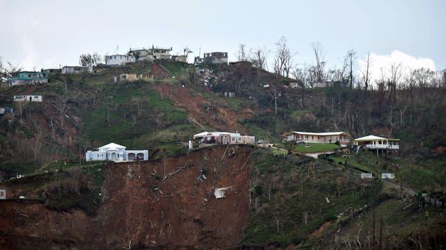 Los deslaves se llevaron varias casas construidas en la montaña. Foto: AFP / Héctor Retamal