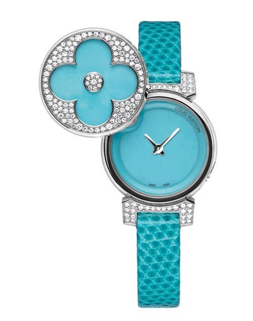 Reloj con tapa de brillantes.