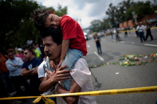 Escenas de dolor en la zona donde asesinaron a Cabral. Foto: AP