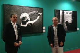 El fotógrafo Aldo Sessa y el ministro de Cultura, Hernán Lombardi, en la inauguración de la muestra