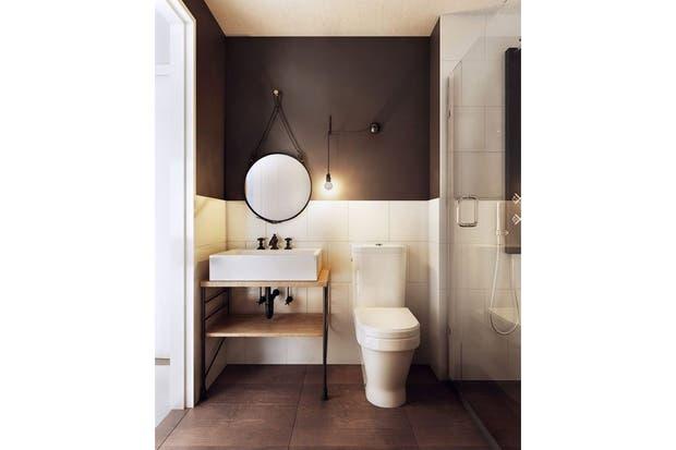 El espejo redondo con marco de cuero y cinturón para colgar le dan un toque actual al baño.  /Homedecorinfo.com