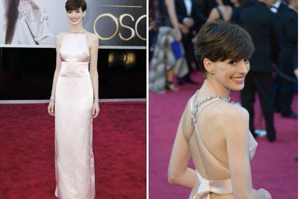 Anne Hathaway fue de las más comentadas por su elección. Un vestido de Prada que generó comentarios varios en Twitter por la manera osada de mostrar sus pechos. La espalda también al descubierto. ¿Qué te parece su vestido esta vez?. Foto: Reuters
