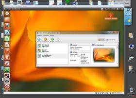 Captura de pantalla del Escritorio de Windows con un Ubuntu Linux corriendo dentro de una máquina virtual, que aparece como una ventana. Sobre esa ventana, el gestor de VirtualBox