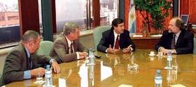 Verani, Lizurume, Rozas y Colombo durante una reunión para interiorizarse por el alcance del paquete de medidas