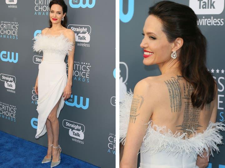 Angelina Jolie, con plumas y de blanco, en un modelo de Ralph Russo