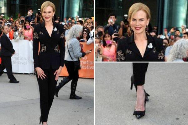 Nicole Kidman, en cambio sorprendió con un outfit masculino: traje negro con detalles de encaje y zapatos Louis Vuitton. Foto: Corbis