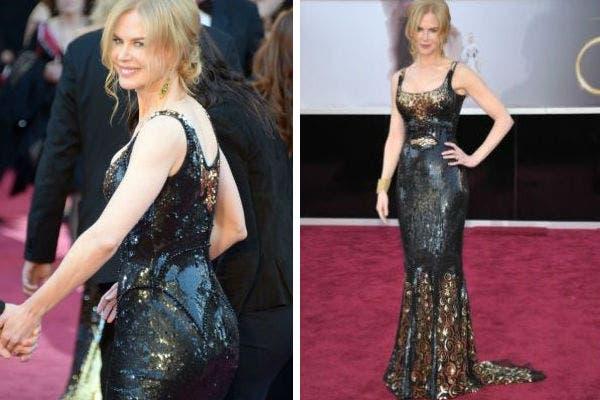 Más de película que de alfombra roja, el vestido de Nicole kidman, una realización de la diseñadora americana L'''' Wren Scott. Mucho brillo y dorado en un vestido de lentejuelas. Foto: AP