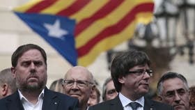Junqueras y Puigdemont, durante una protesta en Barcelona