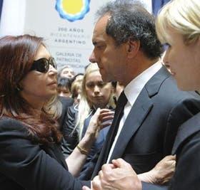 Scioli y su mujer junto a Cristina en el velorio de Kirchner