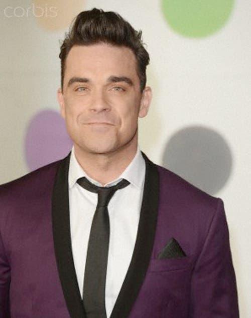 Robbie Williams incluyó la dieta cruda en su plan alimentario y bajó varios kilos.
