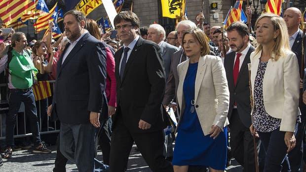 Oriol Junqueras, Carles Puigdemont y Carme Forcadell, tres figuras centrales de la alianza separatista catalana