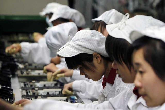 Una línea de producción de productos electrónicos de Foxconn en Shenzhen , China