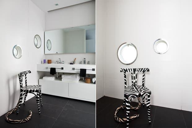La clásica dupla blanco y negro le da personalidad, factor que se maximiza en la silla con estampa animal print, una creación del artista cubano José Franco..