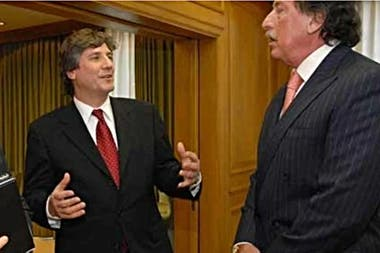 Jorge Brito y Amado Boudou, que ayer expresó su dolor por la muerte del banquero