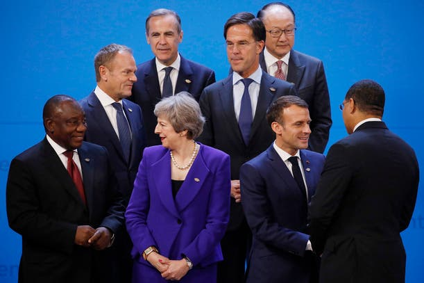 Cyril Ramaphosa, Theresa May, Emmanuel Macron, Macky Sall. Center: Donald Tusk y Mark Rutte. Top, from left, are Mark Carney y Jim Yong Kim