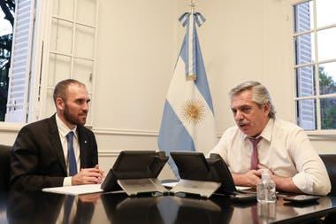 El ministro Martín Guzmán y el Presidente, en una foto de los inicios de la pandemia