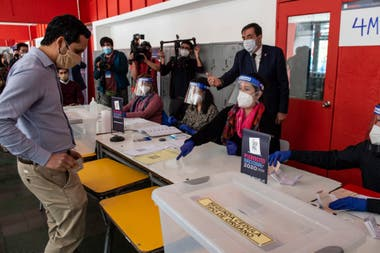 Workers of the Electoral Service of Chile (Servel) participate in a drill showing the press the health security measures ahead of the October 25 referendum