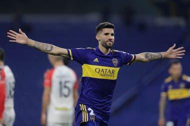 Lisandro López celebra su gol ante Caracas. Boca ganó su grupo y va por más.